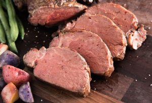pair slices of organic beef tenderloin with russet potatoes