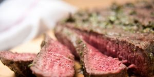 Organic grass fed london broil steak with herb rub cut into strips