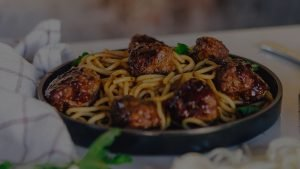 organic frozen meatballs on a plate of spaghetti